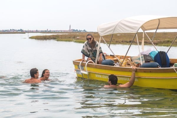 Guys swimming in the Venice Lagoon - Electric Boat Self Drive
